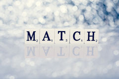 Written word of tiles with letters - match Stock Images