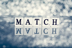 Written word of tiles with letters -  match Stock Photos