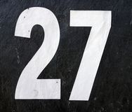 Written Wording in Distressed State Typography Found Number 27 Twenty Seven. Written Wording in Distressed State Typography Found Number on a sign Stock Image