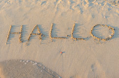 Written words Hallo on sand of beach Royalty Free Stock Photography