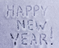 Written words happy new year on white snowy Stock Photo