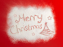 Written words Merry christmas on a snow field, new year concept. Stock Photos