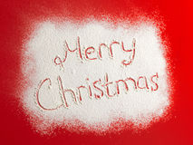 Written words Merry christmas on a snow field, new year concept. Royalty Free Stock Images