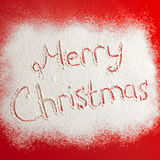 Written words Merry christmas on a snow field, new year concept. Royalty Free Stock Photo