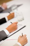 Written work. Image of human hands with pens over business documents Stock Photo