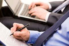 Written work. Close-up of ceo hand with pen making notes at briefing stock photo