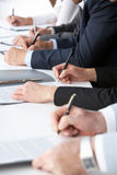 Written work. Close-up of human hands with pens over business documents Stock Images