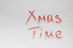 Written `XMas time` on the snow Stock Images