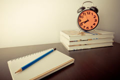 Writter equipment on desk with deadline clock Royalty Free Stock Photography