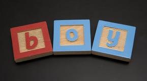 Writtin del RAGAZZO sulla scheda di gesso fotografia stock libera da diritti