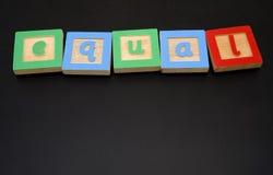 Writtin UGUALE sulla scheda di gesso Immagini Stock Libere da Diritti