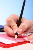 Writting hand with pencil Stock Images