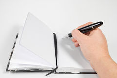 Writting on a notebook Royalty Free Stock Photos