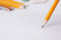 Writting with pencil. On graph paper Stock Photo