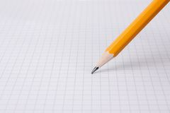 Writting with pencil on graph paper. Close up Stock Photography