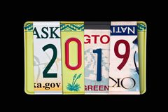 2019 writtten with US licence plates, black background. 2019 writtten with US licence plates, on black background stock photography
