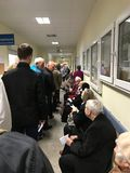 Wrocław, Poland - May 6 2019: Patients of public healthcare waiting in long line to registration room. The line is so long that royalty free stock photos
