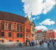 Wroclaw central market square, Poland. Wroclaw, Poland - August 17, 2018: Wroclaw central market square with walking tourists people, old colourful houses stock photos