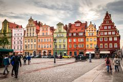 Wroclaw central market square rynek. In Wroclaw old historic town with old colourful buildings and tourists at evening stock photo