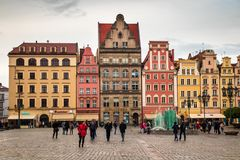 Wroclaw central market square rynek. In Wroclaw old historic town with old colourful buildings and tourists at evening royalty free stock image