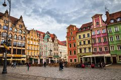 Wroclaw central market square rynek. In Wroclaw old historic town with old colourful buildings and tourists at evening royalty free stock images