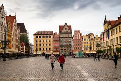 Wroclaw central market square rynek. In Wroclaw old historic town with old colourful buildings and tourists at evening stock photos