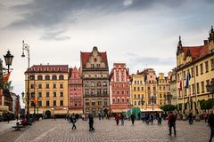 Wroclaw central market square rynek. In Wroclaw old historic town with old colourful buildings and tourists at evening royalty free stock photo