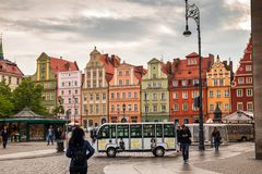 Wroclaw central market square rynek. In Wroclaw old historic town with old colourful buildings and tourists at evening stock photography