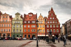 Wroclaw central market square rynek. In Wroclaw old historic town with old colourful buildings and tourists at evening royalty free stock photos