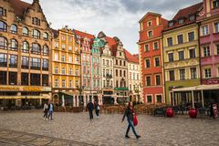 Wroclaw central market square rynek. In Wroclaw old historic town with old colourful buildings and tourists at evening royalty free stock photography