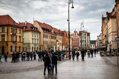 Wroclaw central market square rynek. In Wroclaw old historic town with old colourful buildings and tourists at evening stock image