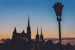 Wroclaw Churches and Lantern Silhouettes by Evening Stock Photo