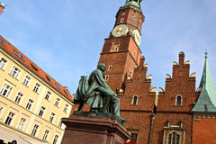 Wroclaw Clock Tower. Close up of the clock tower building and Alexander Fredro in the main square of Wroclaw, Poland royalty free stock photography
