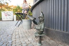 Wroclaw Famous Dwarf, gnome statue, Poland royalty free stock photos