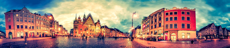 Wroclaw Market Square with Town Hall during sunset evening, Poland, Europe. Panoramic montage from 27 HDR Photos with post processing effects Royalty Free Stock Photos