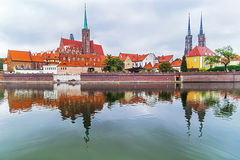 Wroclaw. Picturesque view of famous, old island Tumski with cathedral of St. John reflection in the Odra river. Royalty Free Stock Photos