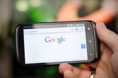 WROCLAW, POLAND - APRIL 05, 2014: Smartphone with Google search website Royalty Free Stock Photo