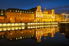 Wroclaw, Poland, August 2018.Ossolineum Library. With reflection in Odra River at night. royalty free stock photography