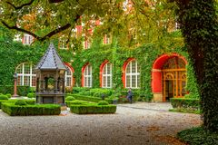 Ossolineum - largest scientific library in Poland– courtyard with beautiful garden. Wroclaw/Poland- August 19, 2017: View of  the Ossolineum - largest Royalty Free Stock Photo