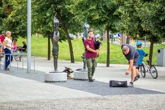Street musician playing bagpipe in a park Stock Photography