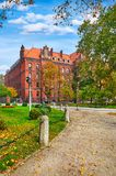Wroclaw Poland building from Metropolitan Seminary Papal. Faculty of Theology at Cathedral square Tumski island green lawn and blue sky with cloud Royalty Free Stock Photography