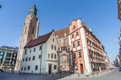 Wroclaw, Poland - circa March 2012: Clock tower of St. Elisabeth Church and Jas and Malgosia buildings in Wroclaw,  Poland Stock Photography