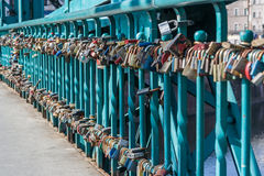 Wroclaw, Poland - circa March 2012: Locks left by lover couples on Ostrow Tumski bridge in Wroclaw,  Poland Royalty Free Stock Images