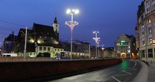 Night traffic in Wroclaw. Wroclaw, Poland - January 03 2018: Night traffic in the city decorated with garlands stock video