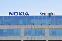 Nokia and Google sign on the wall of the office building. stock images