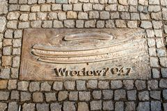 Wroclaw, Poland - March 9, 2018: One of the metal plaques on Wroclaw`s Sidewalk Timeline commemorating influential dates. Wroclaw, Poland - March 9, 2018: View stock image