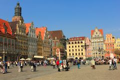 WROCLAW, POLAND - MARCH 30, 2014: scenic market square with townhouses in wroclaw, breslau, lower silesia, poland. Unusual renaissance houses in capital city of stock photo