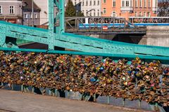 Wroclaw, Poland - March 9, 2108: Symbolic love padlocks fixed to the railings of grunwaldzki bridge, Wroclaw, Poland. Wroclaw, Poland - March 9, 2018: View of Stock Photos