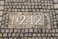 Wroclaw, Poland - March 9, 2018: One of the metal plaques on Wroclaw`s Sidewalk Timeline commemorating influential dates. Wroclaw, Poland - March 9, 2018: View stock images