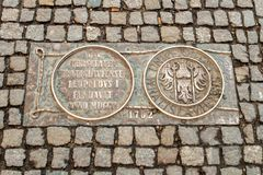 Wroclaw, Poland - March 9, 2018: One of the metal plaques on Wroclaw`s Sidewalk Timeline commemorating influential dates. Wroclaw, Poland - March 9, 2018: View stock photo